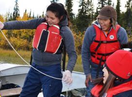 Youth trying sediment sampling equipment (Photo: Meghan Schnurr, WLWB))
