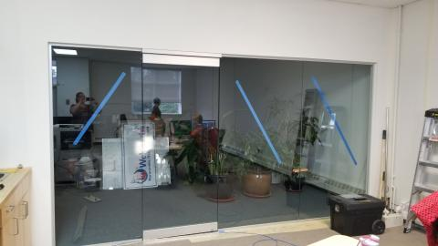 The new glass wall and door between the office and boardroom.