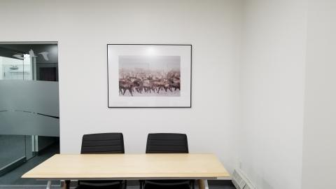 Our interpreters have their own corner with table, chairs, and an amazing photo of caribou.